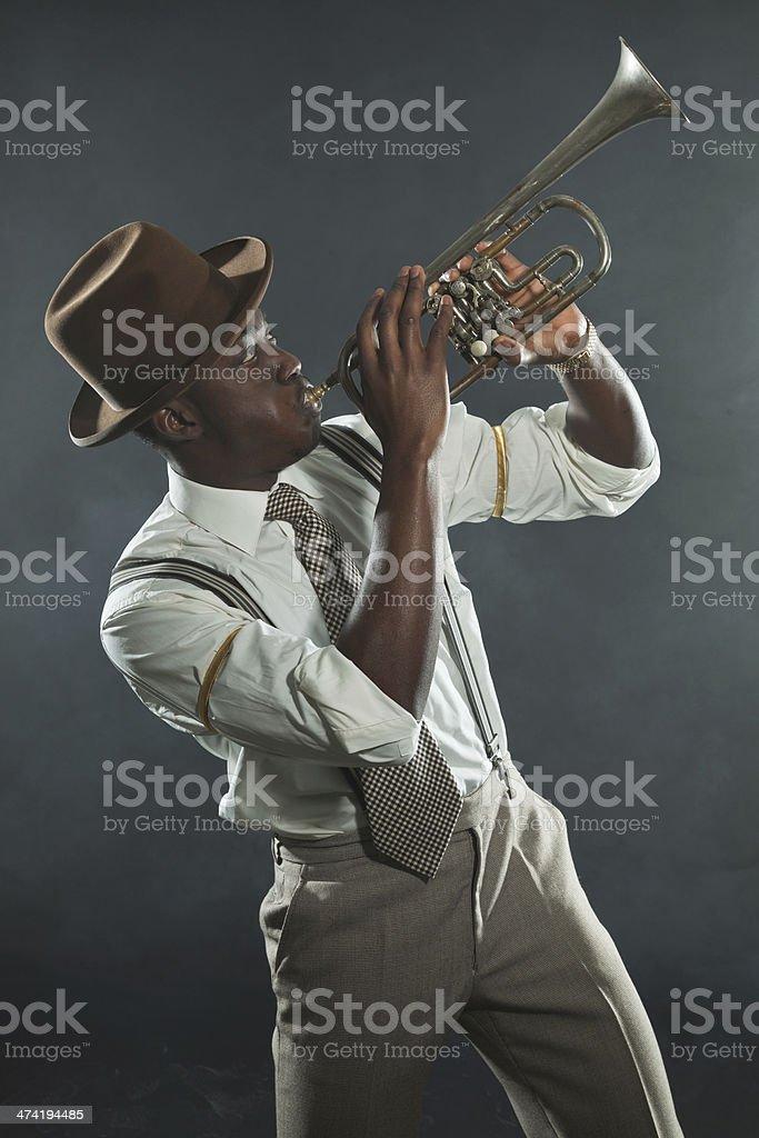 Black african american jazz trumpet player. Vintage. Studio shot. stock photo
