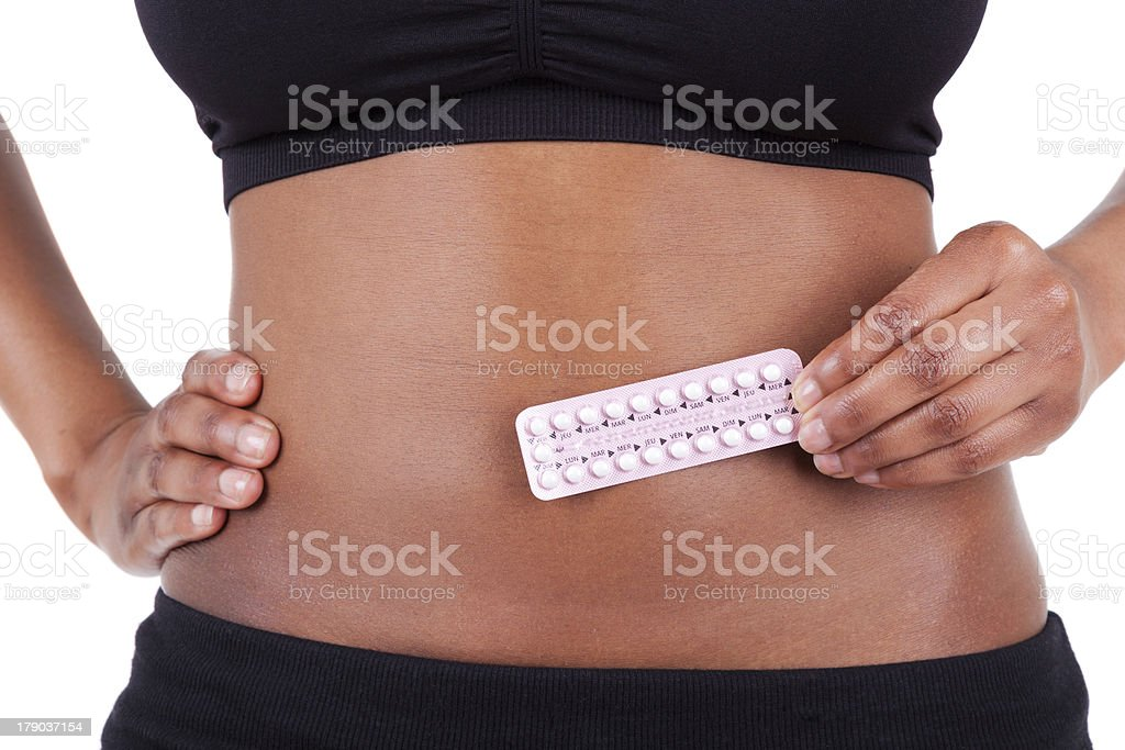 Black African American woman with contraceptives stock photo