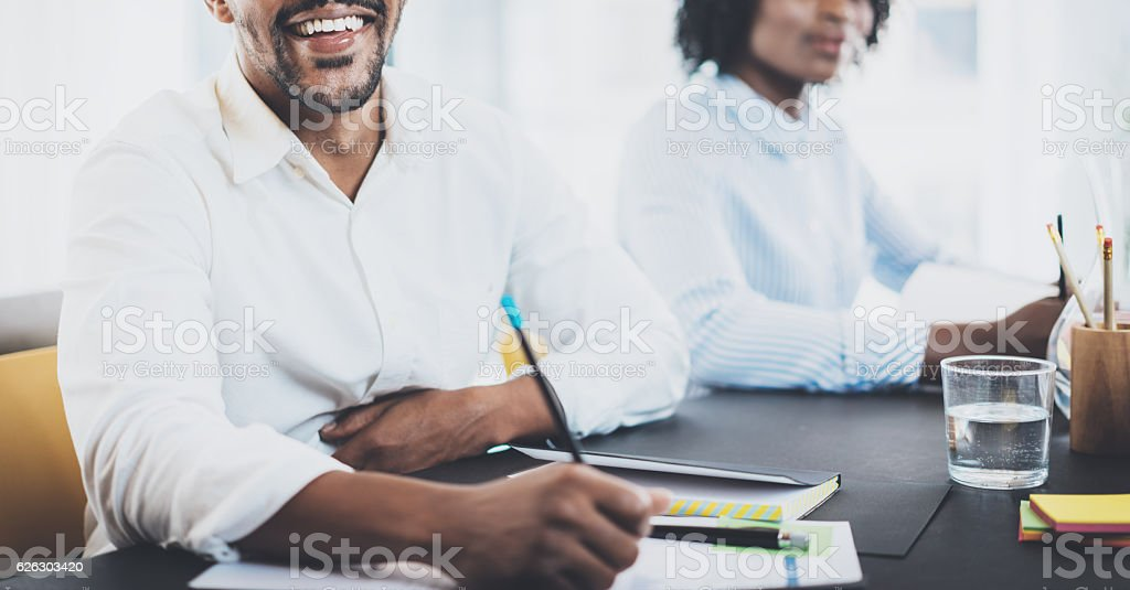 Black african businessman smiling in meeting room.Two young entrepreneurs stock photo