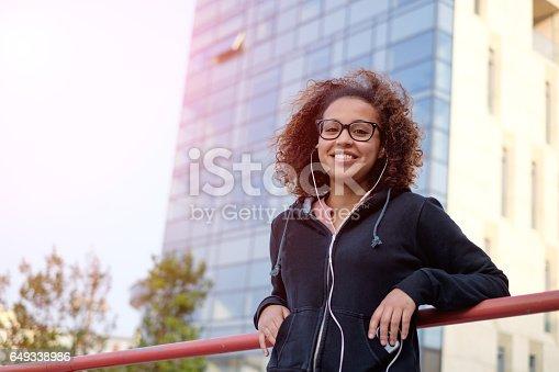 istock Black afro-american woman using mobile phone 649338986
