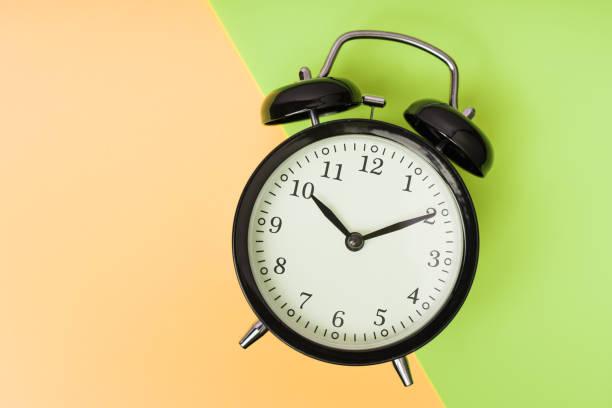 Black alarm clock, concept of time stock photo