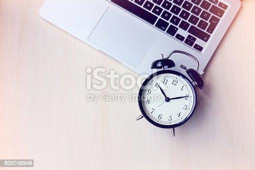 istock Black alarm clock on laptop 835248948