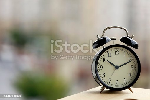 1048940572 istock photo Black alarm clock 1068911868