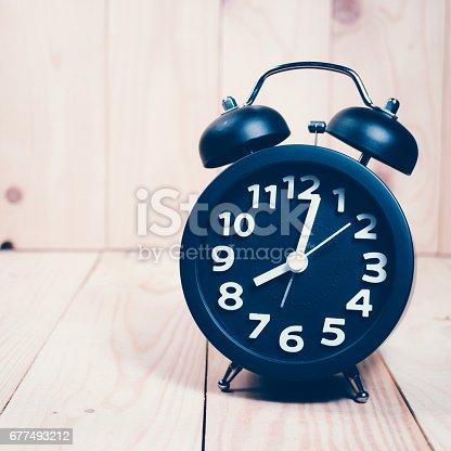 671883446 istock photo Black alarm clock 677493212