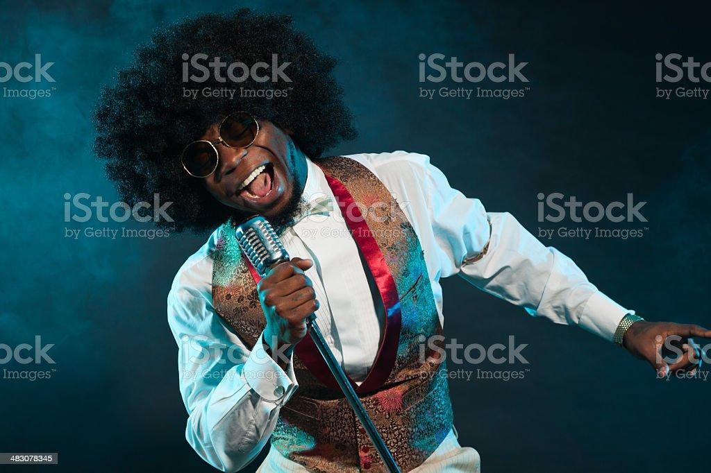 Black american disco soul singer. Vintage. Studio shot. stock photo