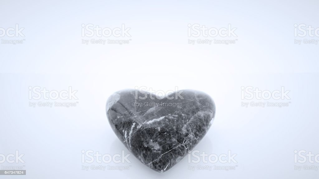 Black and Blue Gem Stone Heart Shape with White Backdrop stock photo