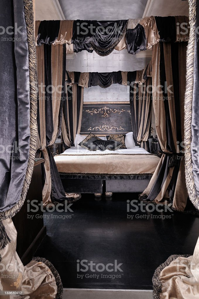 A black and brown bedroom with curtains royalty-free stock photo