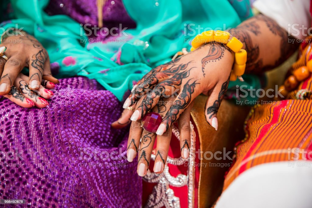 Black And Brown Henna Hands Drawings On Women For African Wedding