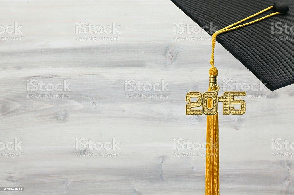 Black and Gold 2015 Graduation on White Wood Background stock photo