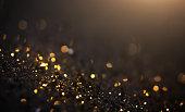 istock Black And Gold Glitter Background - Christmas, Celebration, Luxury 1282693460