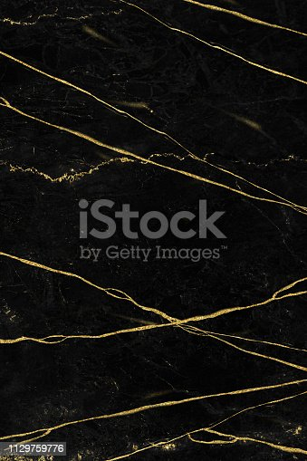Black and gold marble texture design for cover book or brochure, poster, wallpaper background or realistic business and design artwork
