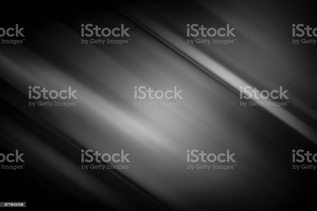 Black and gray background with gradient and silver light as...
