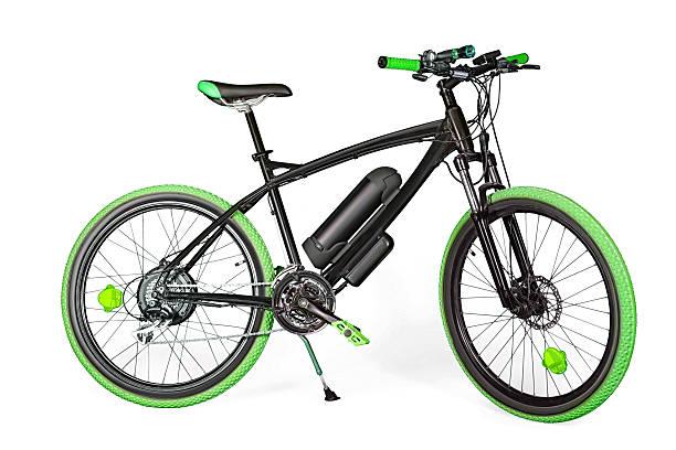 black and green electric bike - elektrorad stock-fotos und bilder