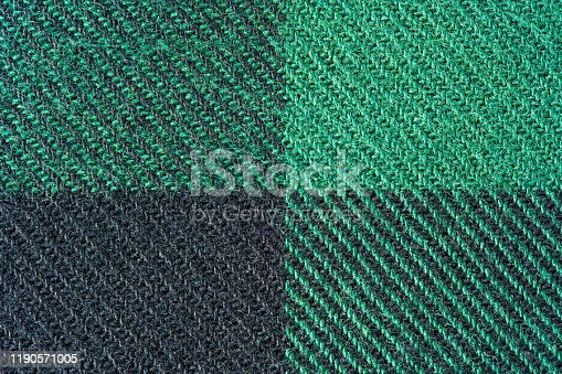 Black and Green Fabric in a Cage. Blanket Material. Clothes Background