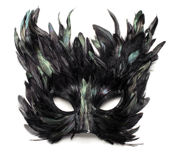 Black and green feather cat mask (isolated) stock photo