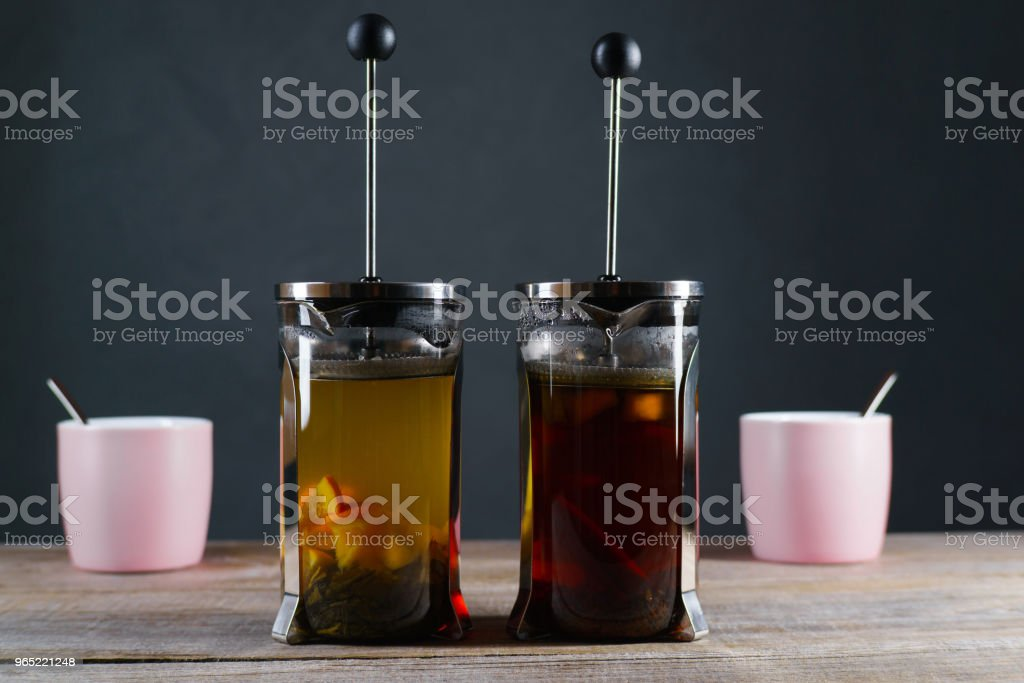 Black and green tea with citrus in french press royalty-free stock photo