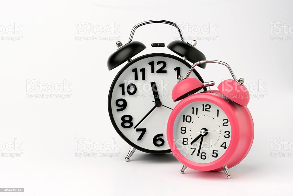 Black and Pink Table Alarm Clock on White Background stock photo