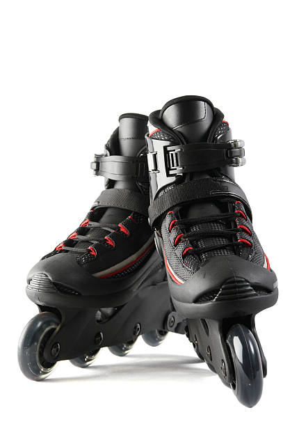 Black and red inline skates on a white background  stock photo