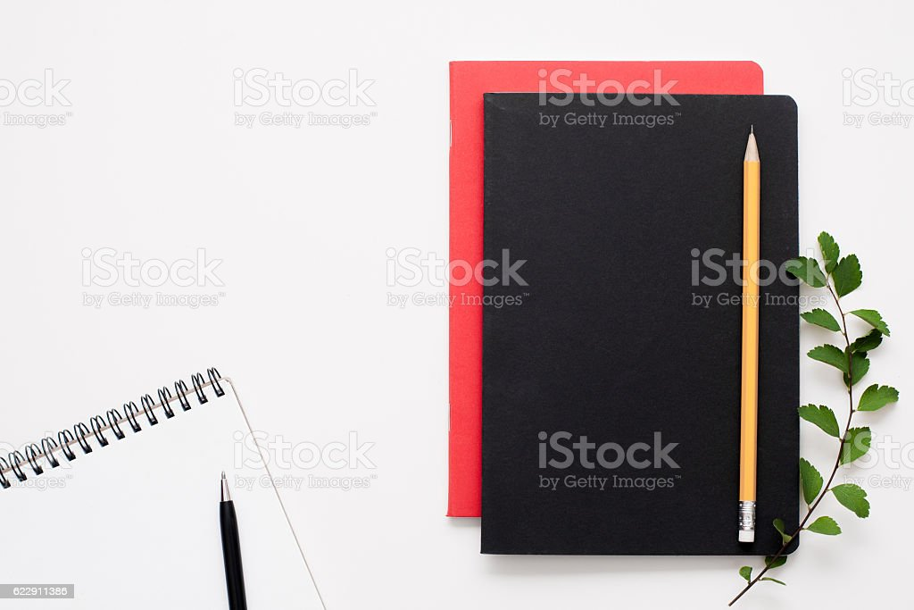 Black and red notepads with open one, free space stock photo