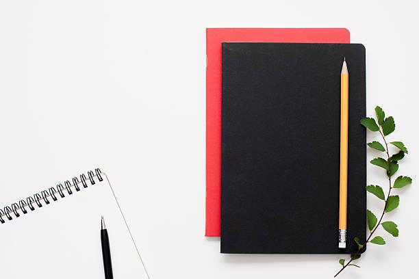 black and red notepads with open one, free space - folha de caderno imagens e fotografias de stock