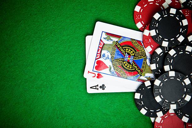 black and red poker chips in the background. - black jack bildbanksfoton och bilder