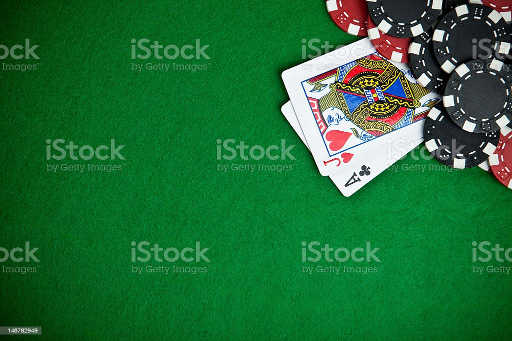 Black and red poker chips with jack and ace card on table stock photo