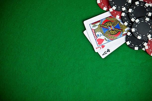 black and red poker chips with jack and ace card on table - black jack bildbanksfoton och bilder