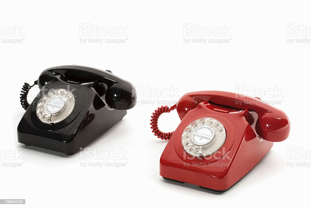 black and red rotary phone stock photo