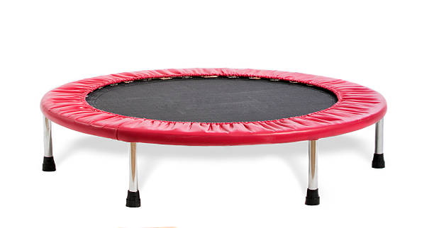 Black and red small trampoline isolated on white stock photo
