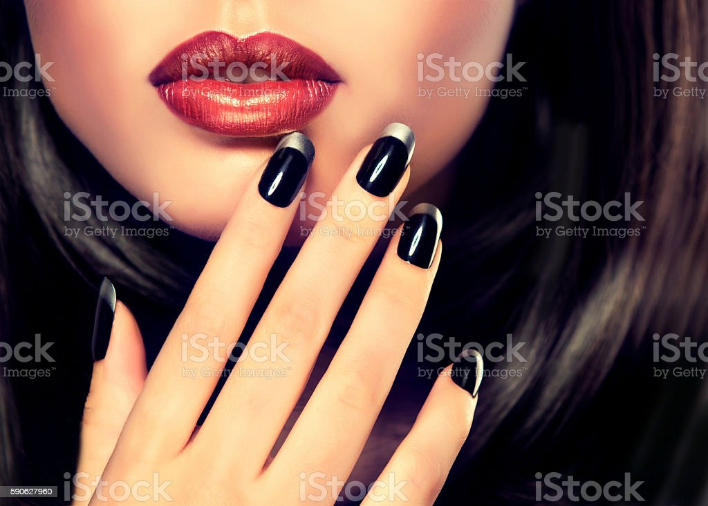 Black and silver French-style manicure. stock photo