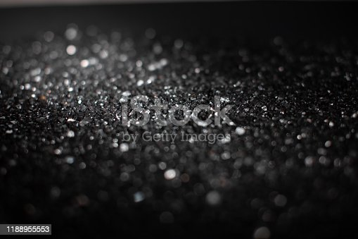1054573800 istock photo Black and white abstract background with bokeh defocused lights 1188955553