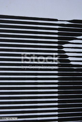 537400206 istock photo Black and white abstraction of white stripes and black stripes super background, art. 1176747629