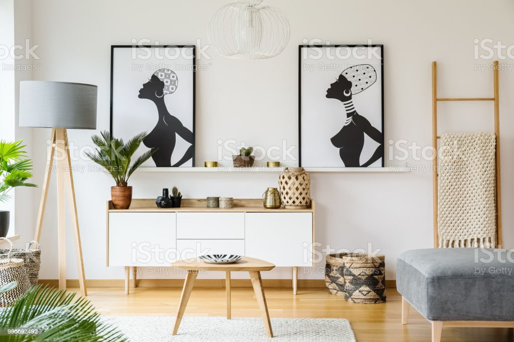 Black And White African Posters Above Cabinet In Living Room ...