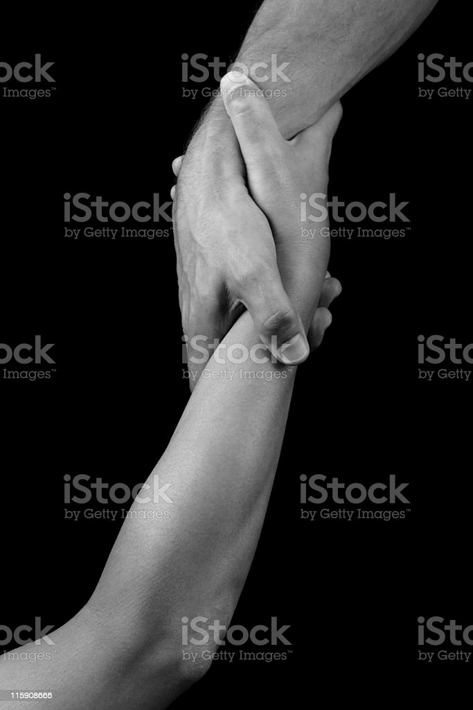 Black and white arms holding hands stock photo