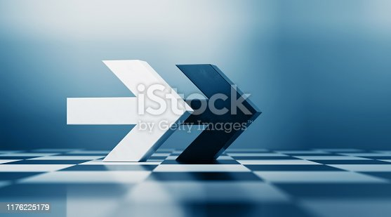 istock Black and White Arrows Pointing  Same Direction on Chess board 1176225179