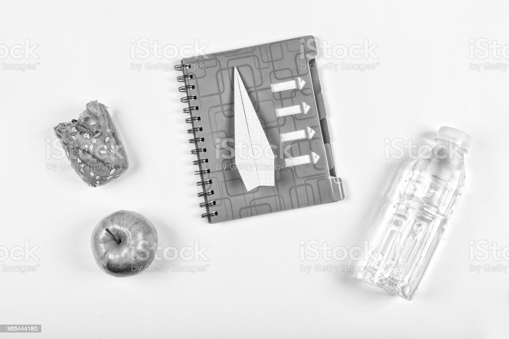 black and white. Back to school, notebook, school snack. accessories, notepad, stationery, Free space for text. Copy space. top view royalty-free stock photo