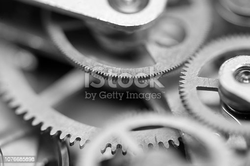 Black and white Background with metal cogwheels clockwork. Concept Teamwork. Macro.