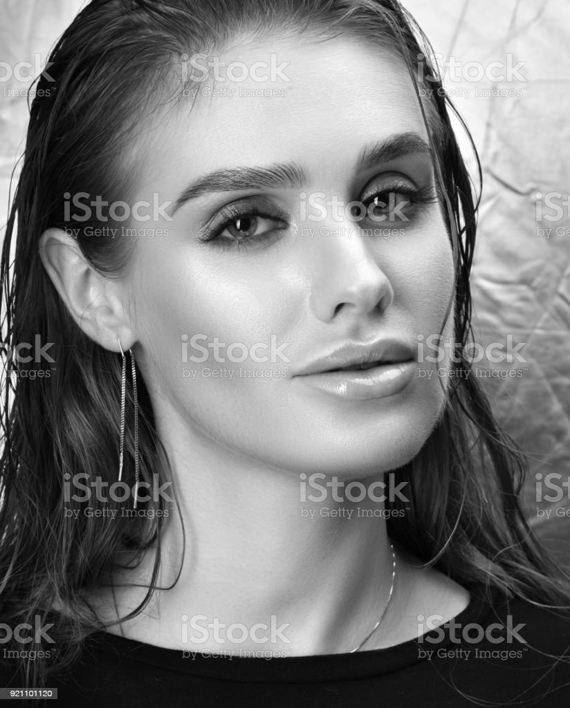Black and white beauty portrait of beautiful young woman with professional makeup stock image