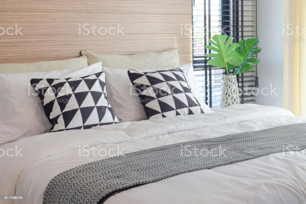 Black and white bedding style and crystal jar next to bed