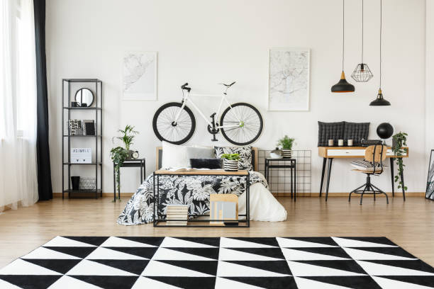 schwarz und weiß schlafzimmer - teppich geometrisch stock-fotos und bilder