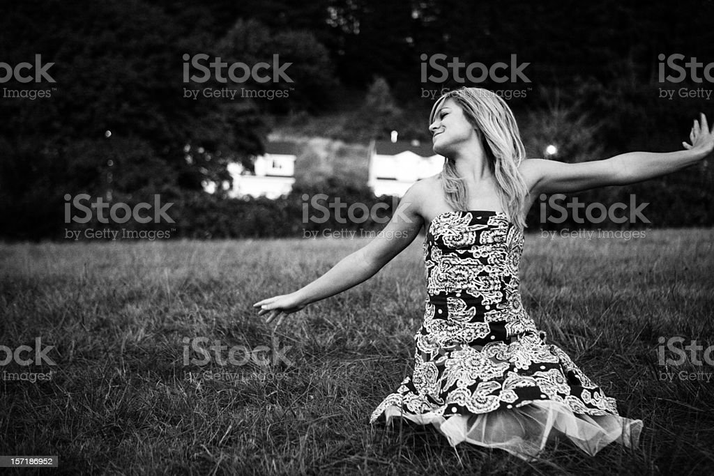 Black and White Blonde Girl Feeling Free. royalty-free stock photo