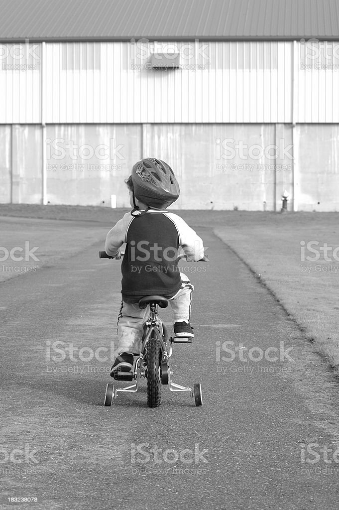 Black and white boy on bicycle royalty-free stock photo