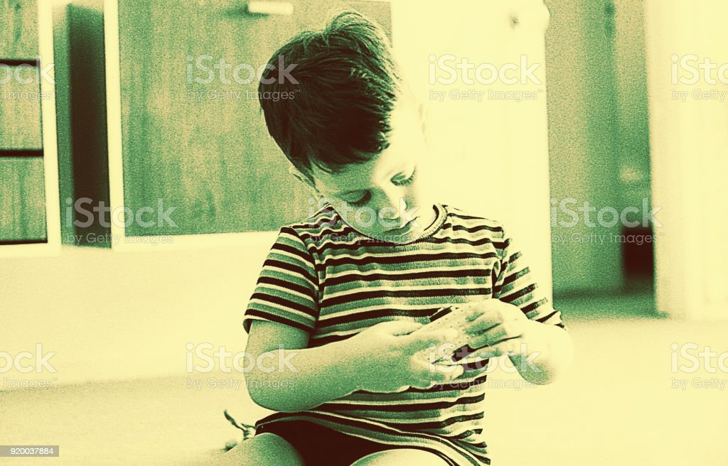 Black and white boy playing at home stock photo