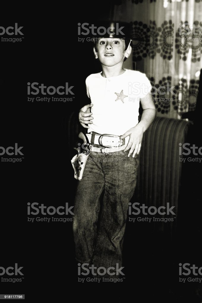 Black and white boy playing the cowboy stock photo