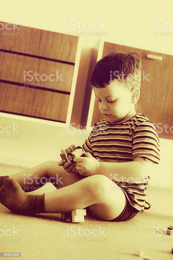 Black and white boy playing very focused stock photo