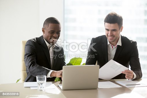 istock Black and white businessmen working together 843533916