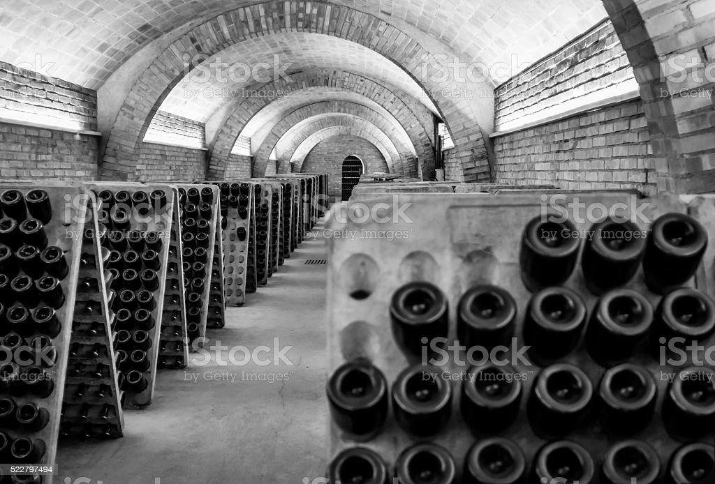 black and white cellar champagne cava wine unrecognizable dark bokeh stock photo