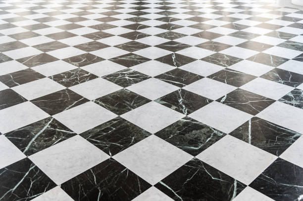 Black and white checkered marble floor – Foto