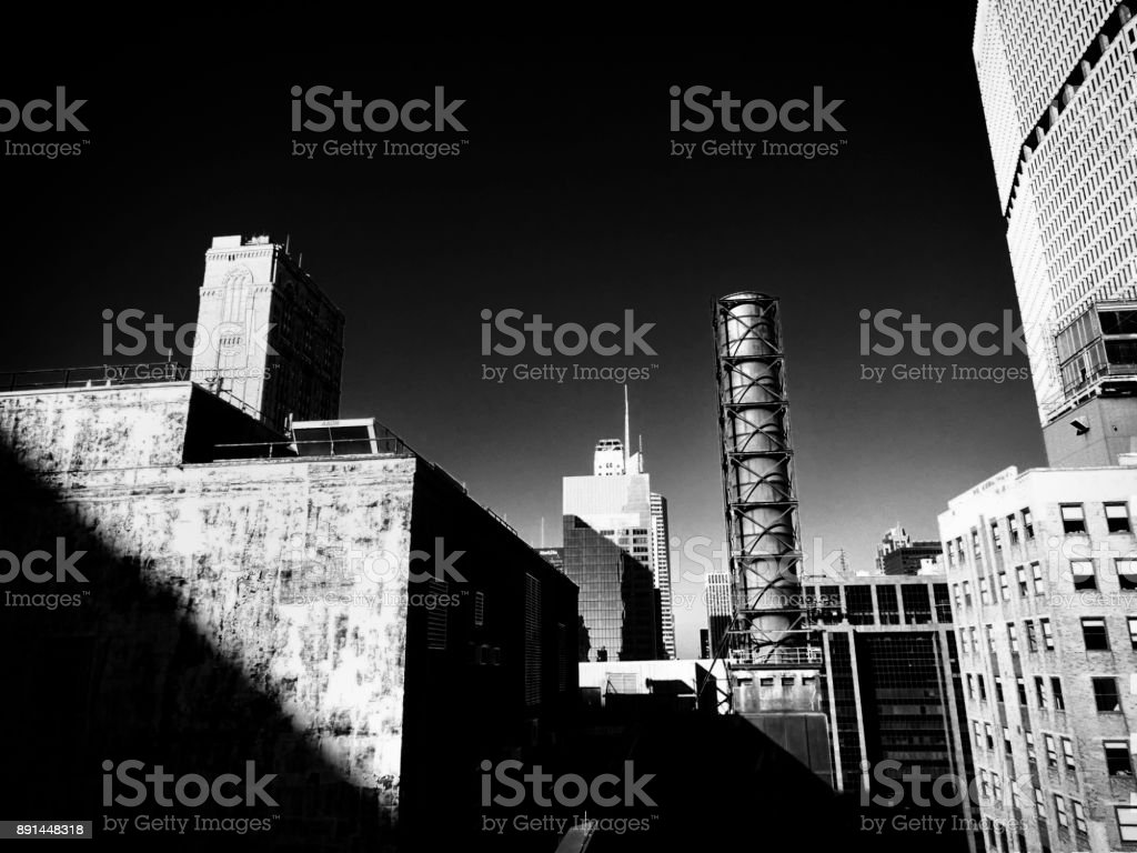 black and white city scene buildings stock photo