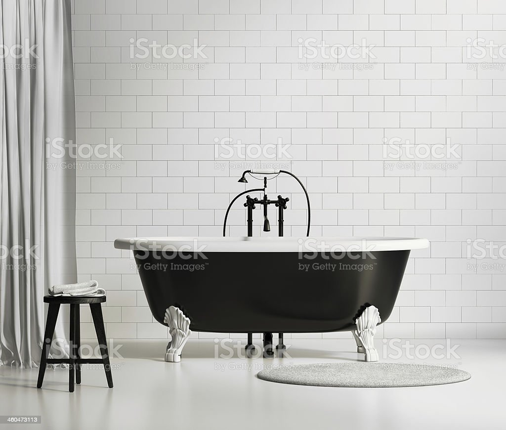 Black and white classic bathtub on brick wall stock photo